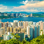 Magnificient daytime view of Kowloon as seen from a peak on Dragon Back hiking trail in Hong Kong.