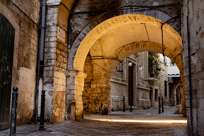 Archway courtyard at sunrise, Bari, Italy