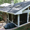 Navajo Trail Screened porch:<br /> The  new roofline was tied into the existing roof  and screens were framed to look like windows so the porch felt like an extension of their home.  After removing the old, deteriorating retaining wall we cut into the hill to open up the grilling area and rear entry into the yard.  (The old retaining wall followed the edge of the patio.)
