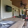 View from wet bar with Shirestone tops.  TV is on swivel mount viewable from pool or porch lounge furniture.