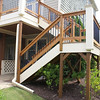 New custom deck railing with metal ballusters replaced sagging builder grade railing. Stair risers (not shown) were added to meet code requirements for child safety.
