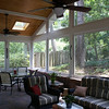 Navajo trail Screened Porch Interior:<br /> The old, deteriorating, brick retaining wall and concrete slab were replaced with a paver stone floor and wall as part of the addition.