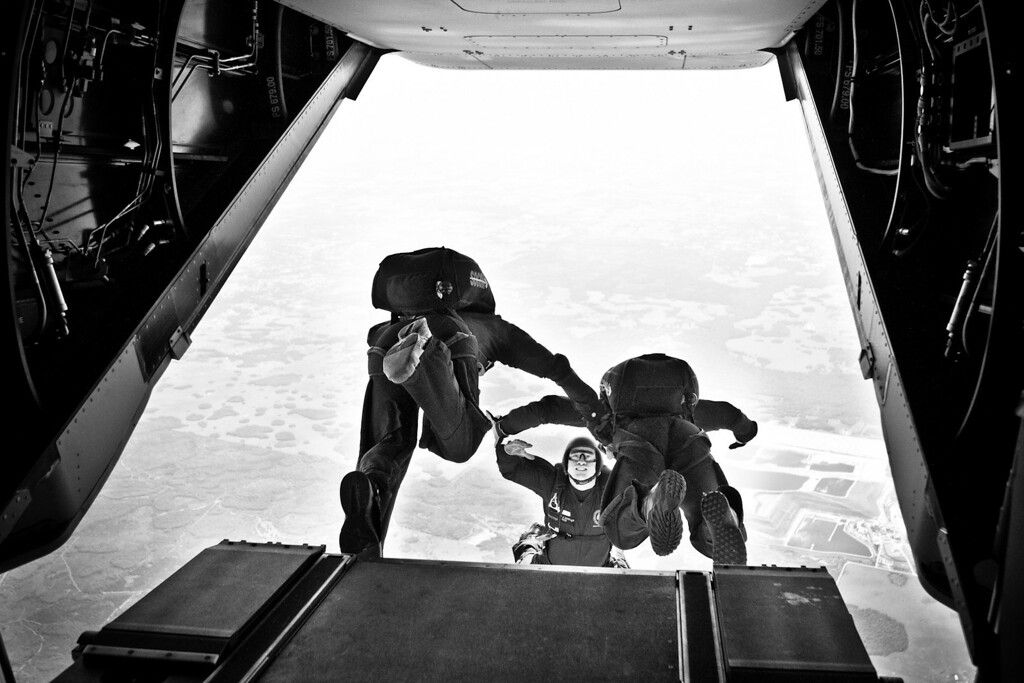 In one breathtaking moment, the SOCOM Paracommandos aboard the MV-22 Osprey aircraft make the transition from a hull beneath their feet to the skies above the Earth, as they make their final jump of the day at Sky Dive City in Zephyrhills, Florida on February 12th, 2012.  <br /> <br /> In this particular image, the paracommandos are attempting a formation and mid-dive movement with multiple parts.  It is critical, during these maneuvers, for the paracommandos to remain incredibly close together when exiting the aircraft.