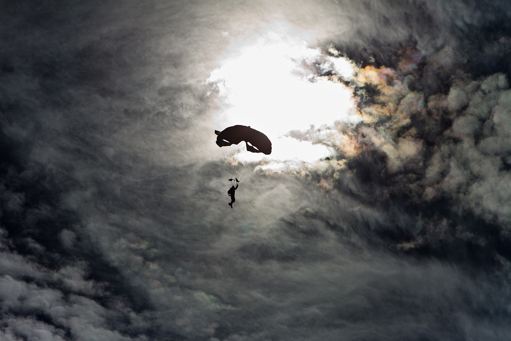 A SOCOM Paracommando drifts in front of the sun as he makes his way to the landing zone following his jump from the MV-22 Osprey tiltrotor aircraft in Zephyrhills, Florida, February 12th, 2012.