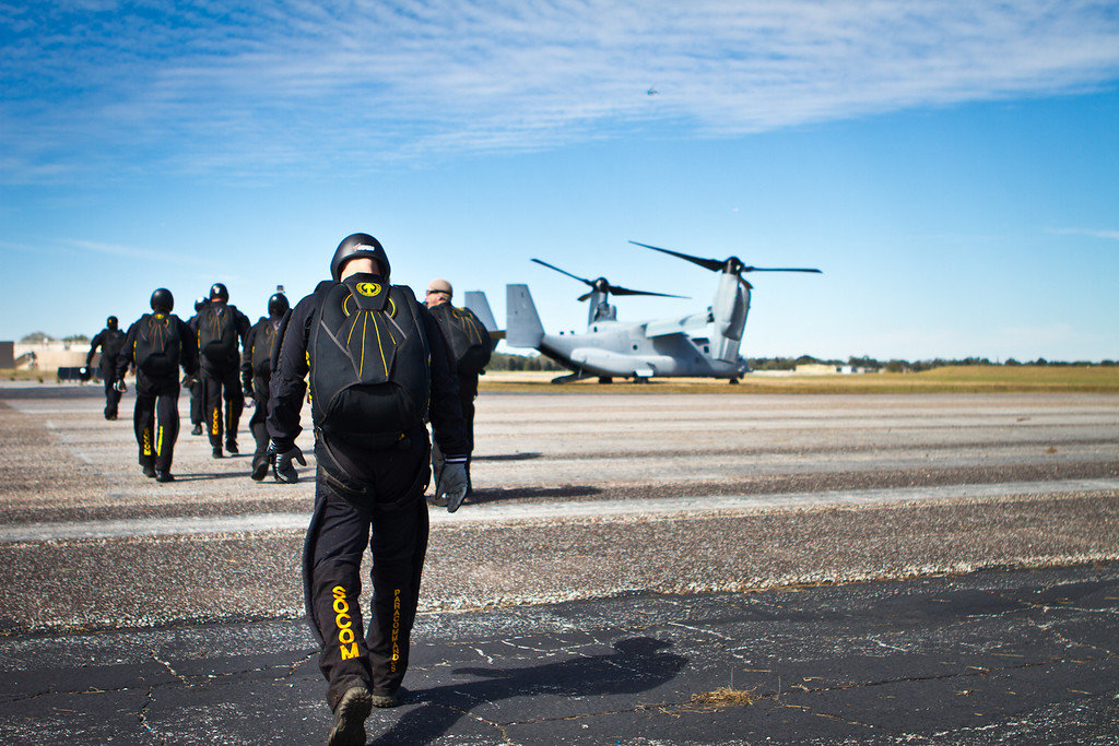 A group of SOCOM Paracommandos make their way to the MV-22 Osprey tiltrotor aircraft for a jump at Sky Dive City in Zephyrhills, Florida, on February 12th, 2012.