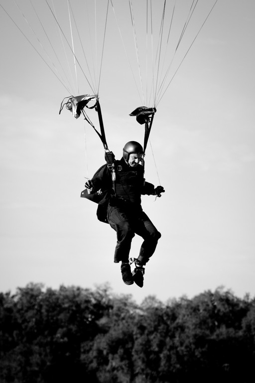 A SOCOM Paracommando prepares to land after jumping from the MV-22 Osprey at Sky Dive City in Zephyrhills, Florida, February 12th, 2012.