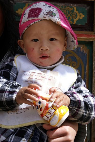 TIBETAN GIRL. SHANGRI-LA. YUNNAN. CHINA.