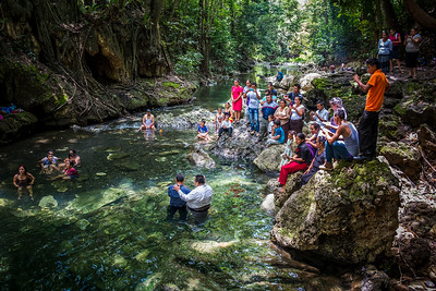 Catholic ceremony - immersion baptism in a river