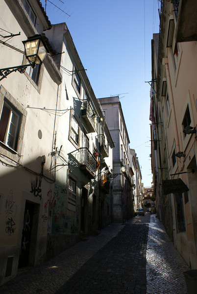 LISBON. LISBOA. BARRIO ALTO. NARROW STREET IN THE AFTERNOON.