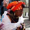 LISBON. LISBOA. ROSSIO. PRACA DOM PEDRO IV. AFRICAN WOMAN IN COLOURFUL DRESS.