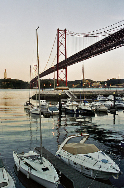 LISBON. LISBOA. VIEW ON THE HARBOUR AND THE BRIDGE IN THE RIVER TAGUS FROM AS DOQUES.