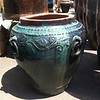 "Pottery with handles & grapevine design motif<br /> Blue Green drip glaze<br /> Approx 30"" Ht x 32"" W"