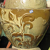 """Detail pottery with flower motif<br /> Yellow-Gold drip glaze<br /> Approx 36"""" w x 30"""" Ht"""