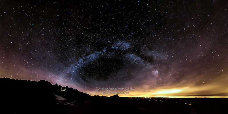 """Midnight in a Perfect World"".  The Milky Way archs over Hen Cloud and the Roaches with the Potteries in the distance"