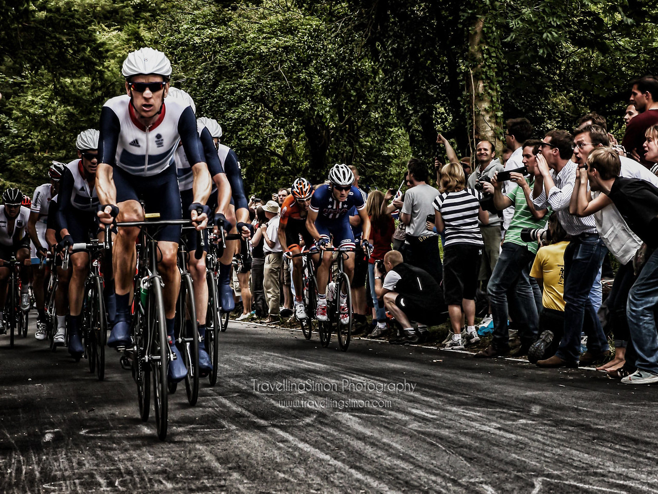 Britains first ever Tour de France winner Bradley Wiggins drives the peloton hard in the Men's Road Race of the London 2012 Olympics, in a vain attempt to catch the breakaway, here seen at Box Hill, Surrey. Congratulations on winning an awesome Olympic Gold in the Time Trial, Wiggo!