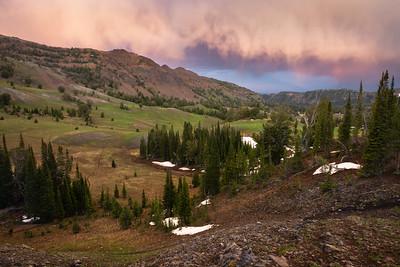 Sunset clouds over subalpine valley, Wallowa Mountains, Oregon