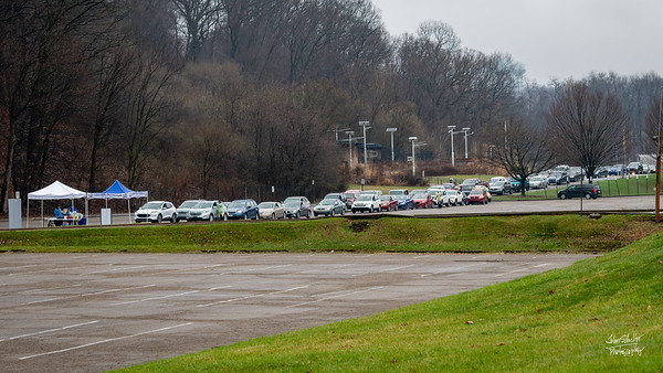 Cars lined up for hours, for a drive-thru test.