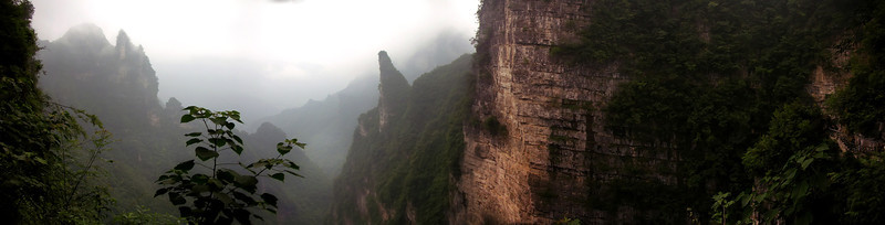 "This Chinese National Park is called something like ""Shi (long i) Bu She"" – On this self guided tour, you walk on a three foot wide pathway that is carved into the side of a thousand foot cliff and look out into the mist.  This place literally takes your breath away and is definitely not for the faint of heart.  Of all the places I have ever been - there has never been another quite like this!  It ranks as one of the top three places I have ever been."