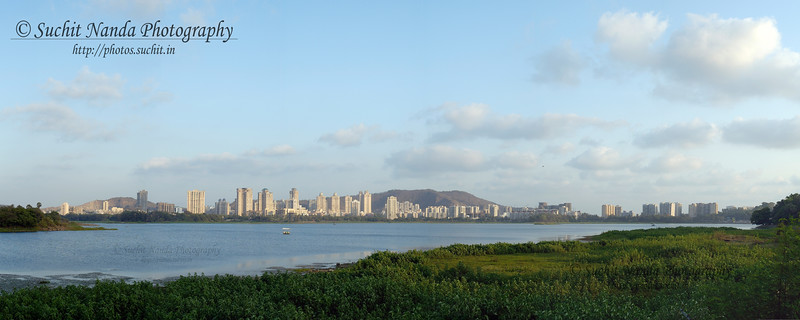 Panoramic view of Hiranandani Gardens across Powai Lake.