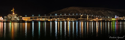 Night view of Tromso Bridge with lights in the city of Tromso in Norway
