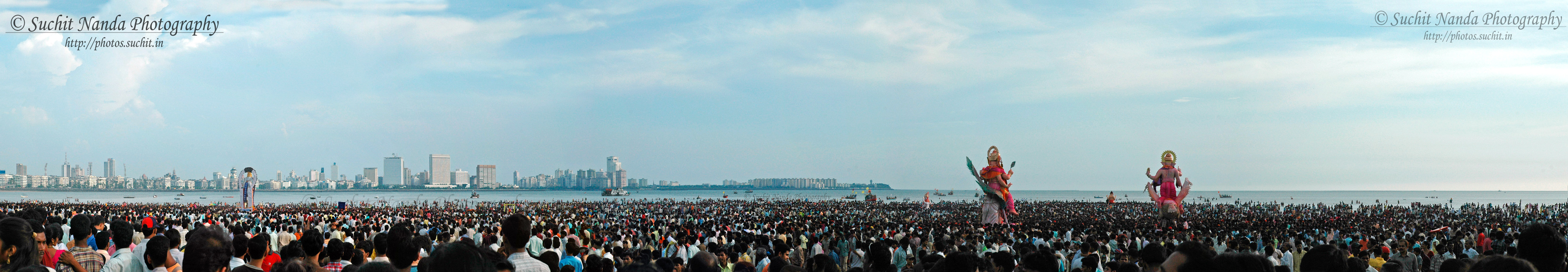 Huge congression of people for Ganapati Visarjan at Chowpatty beach, Mumbai (Bombay).  Hindu God, Ganesh is the god of good fortune. During Ganesh festival the idol of Lord Ganesh is bought into many homes and worshipped for 10 days, and on the 11th day the idol is immersed in water.  See it large size by clicking:  http://photos.suchit.in/photos/388767382_j88od-O.jpg