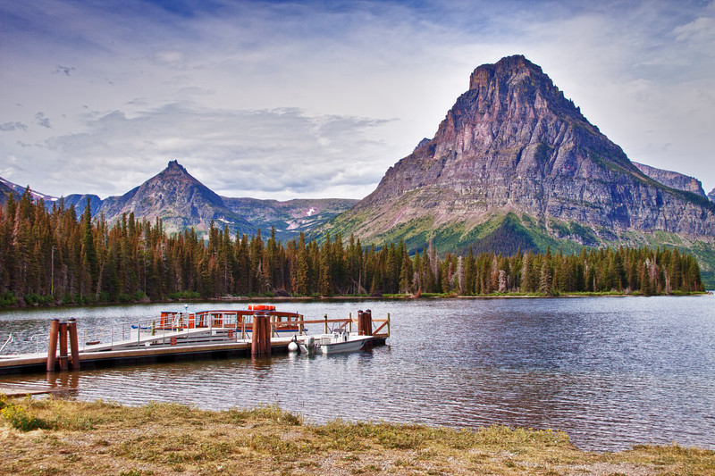 HDR image of Two Medicine Lake and dock with Sinopah mountain - in Glacier National Park in Montana.