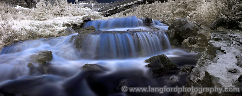 """Infrared Glacial Falls - Glacier National Park, Montana  This infrared panoramic was shot with my Canon 10D and 20mm lens using a Hoya R72 filter.  Each exposure was 8 seconds long.  I combined the 8 exposures using Panorama Factory.  In photoshop, I swapped the Red and blue channels to create the blue color. <BR><BR>Want to buy a print of this image?  Click <a href=""""http://www.langfordphotography.com/For-Sale/New-Site-Panormaics/9004552_h7zw9H"""">Here</a>!"""