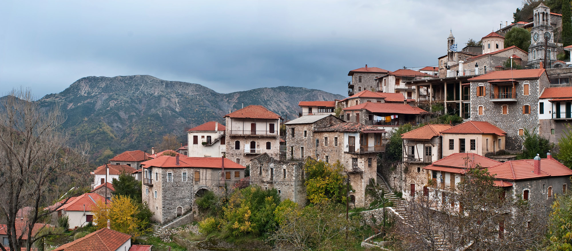 <b><font>Lagadia | Greece</font></b> Houses built on the steep mountain side at a village on the middle of Peloponnese