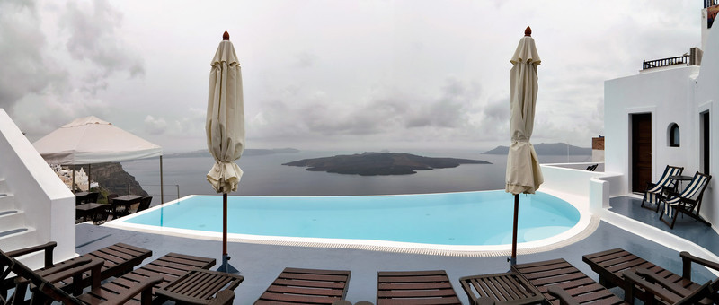 <b><font>Santorini | Greece</font></b> Grey sky and rainy weather... even more dramatic a landscape for this island!
