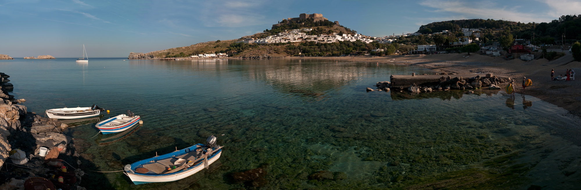 <b><font>Lindos (Rhodes) | Greece</font></b> Calm and crystal-clear waters of the Lindos beach