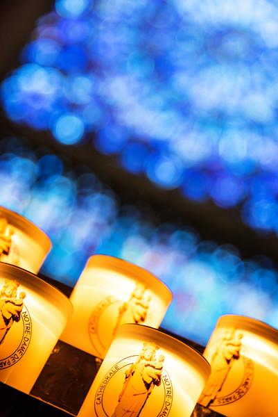 Lit Prayer Candles at Notre Dame Cathedral (Paris, France)