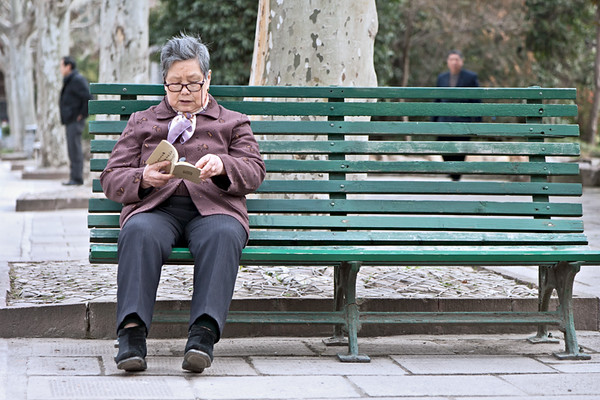 51) Women Alone on Bench Reading