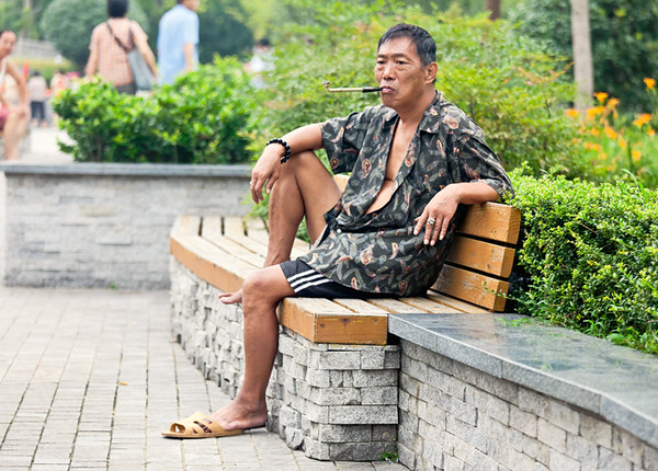 2) 	Camo Man Smoking on Bench