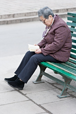 48) Woman Alone on Bench Reading