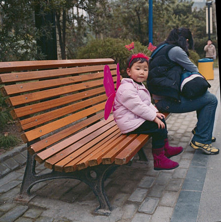 11) Child on Bench