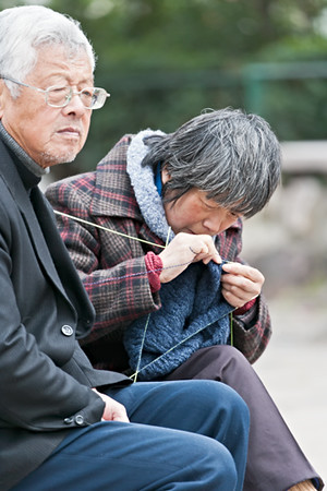 30) 	Woman Knitting with Man 3