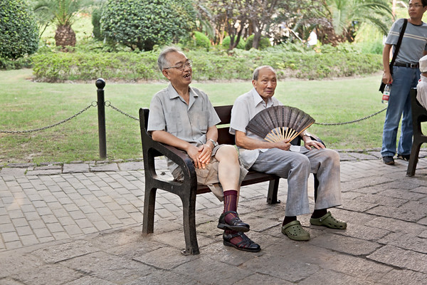 46) 	Two Men on Bench with Fan