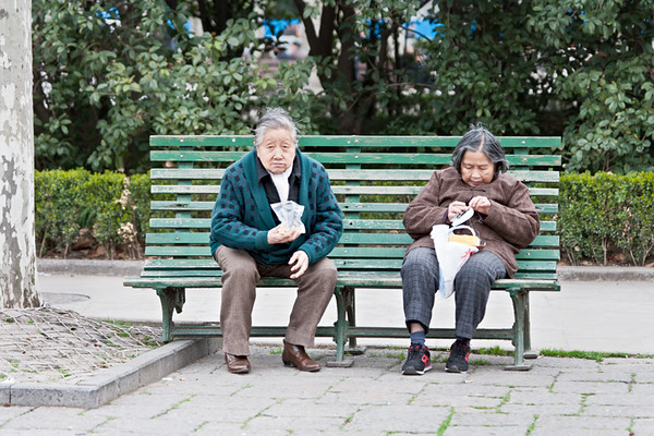 50) Two Women on Bench Eating 2