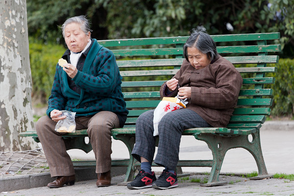 49) 	Two Women on Bench Eating 1