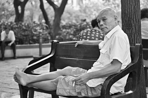 54) Man on Bench SLJ BW