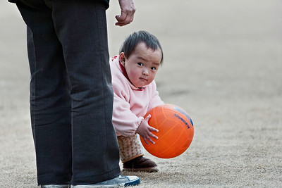 19) 	Baby and Ball