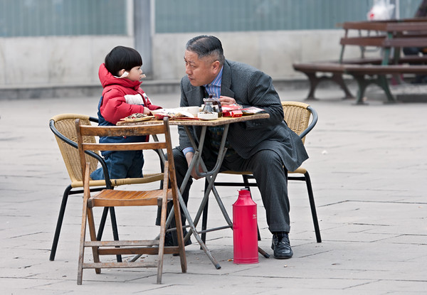 12)	Child and Grandfather Eating 2