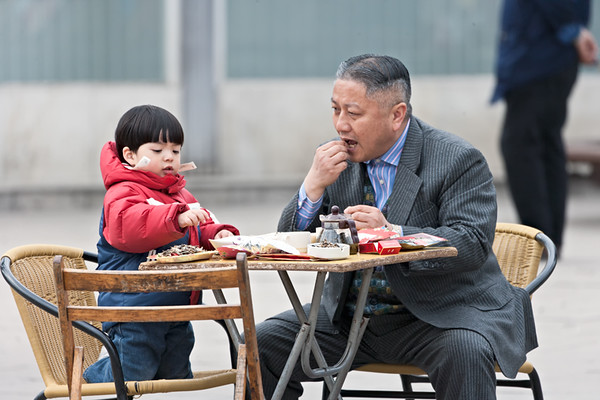14) 	Child and Grandfather Eating 1