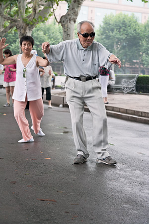 29) 	Man Dancing in Street