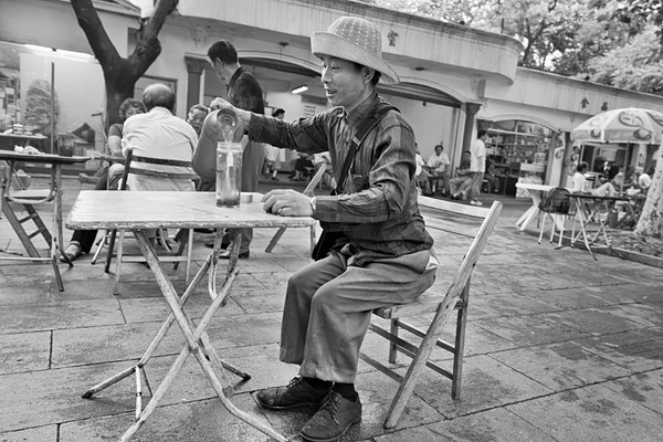 15) 	Man Pouring Tea BW