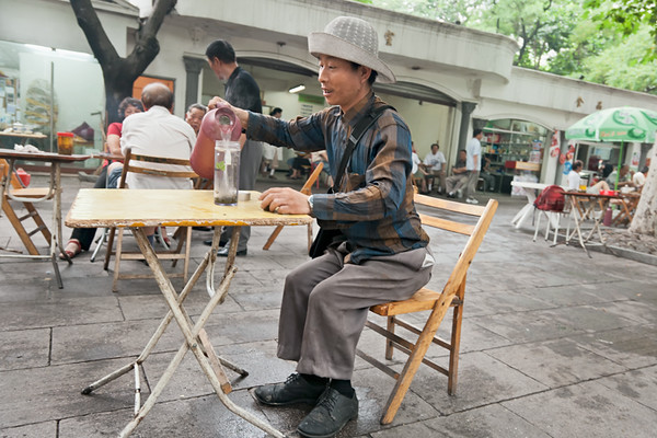 16) 	Man Pouring Tea