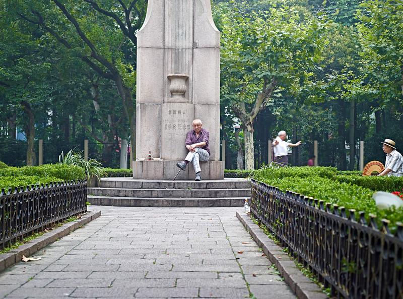 29) Man sitting in Park