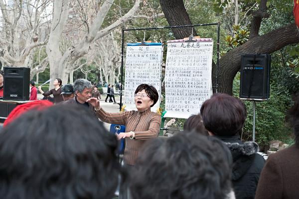 19) Woman Leader Singing