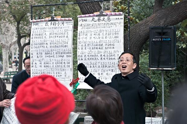 16) Man Singing Red Hat