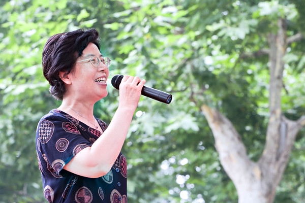 21) Woman Singing with Mic